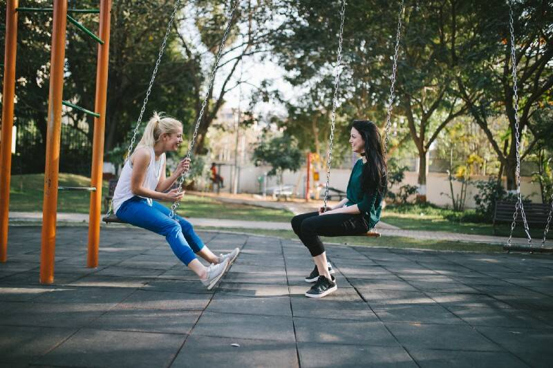 Two women on swings