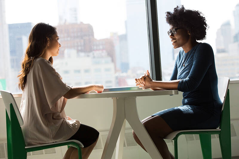 Women at a table talking