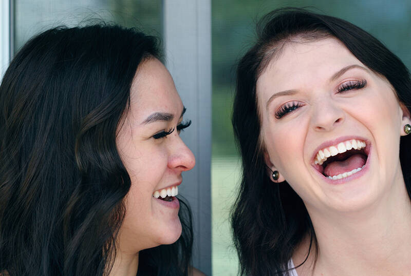 Two female friends laughing together